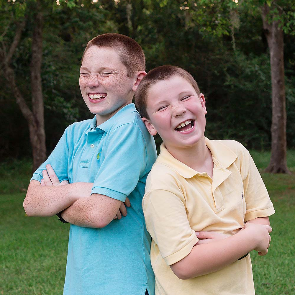 Brothers laughing together for a family portrait