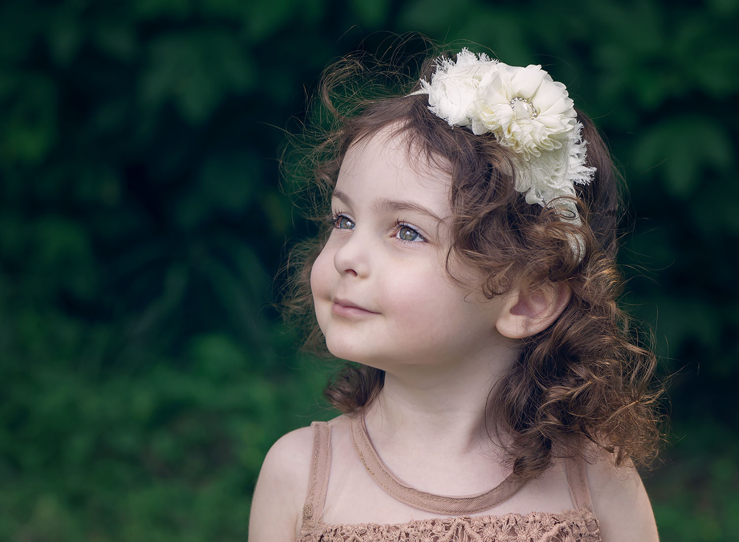 Dreamy portrait of girl wearing lacy headband gazing off camera