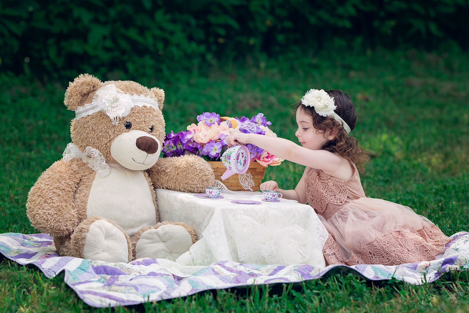 Girl enjoying a tea party with victorian theme including pearls and lace