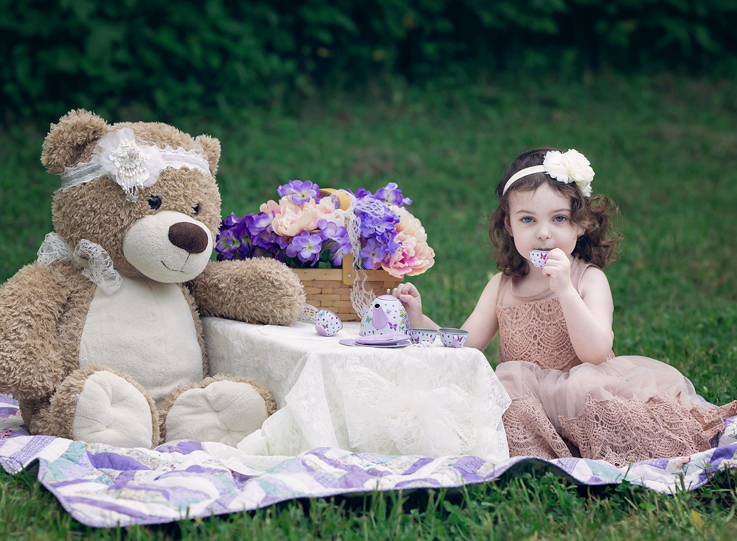 Teddy bear picnic on location with flowers and lace